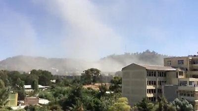 A plume of smoke rising in Mekelle after an airstrike