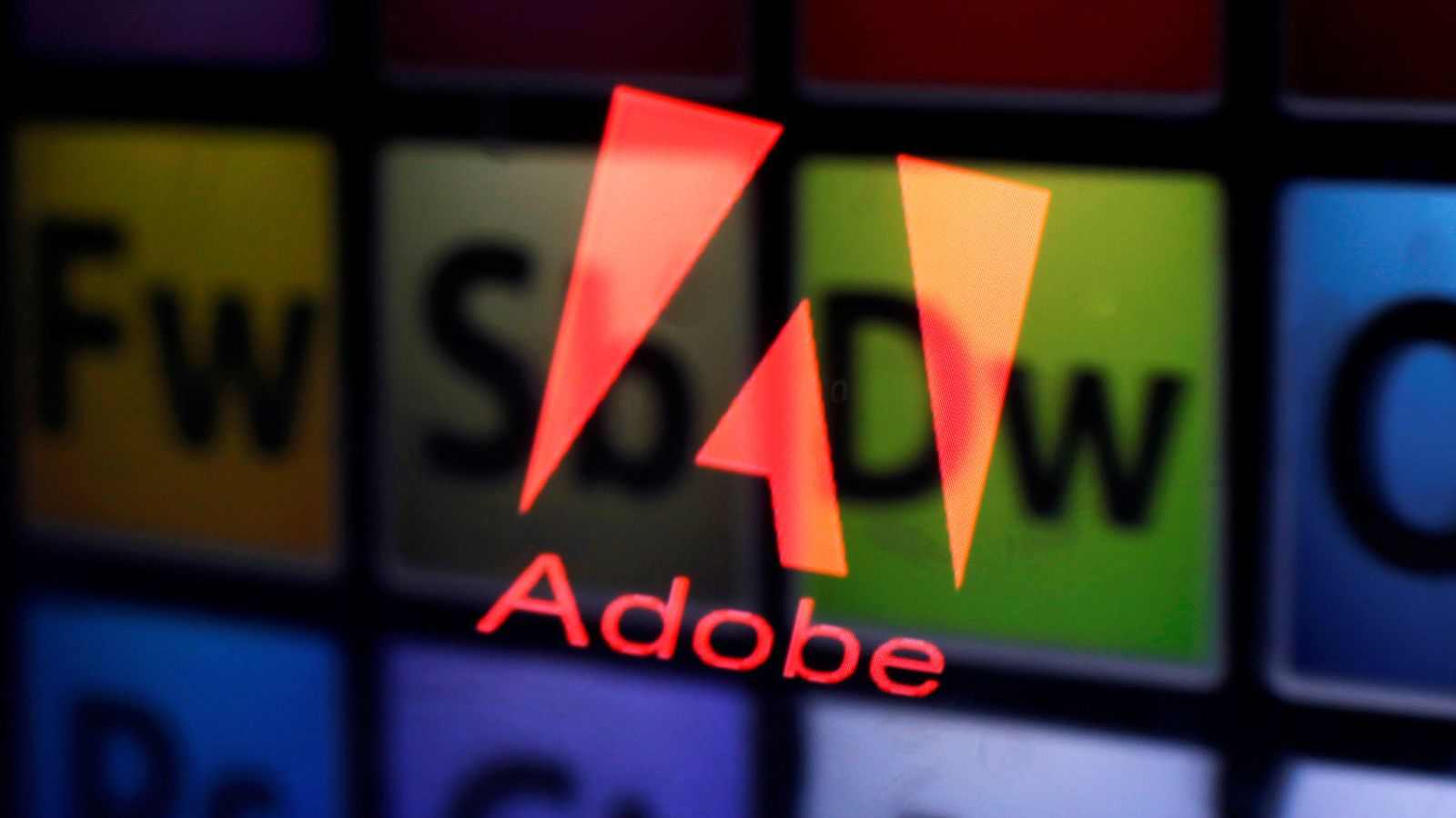 An Adobe logo and Adobe products are seen reflected on a monitor display and an iPad screen, in this picture illustration July 8, 2013. REUTERS/Dado Ruvic/Illustration/File Photo GLOBAL BUSINESS WEEK AHEAD PACKAGE Ð SEARCH ÒBUSINESS WEEK AHEAD SEPTEMBER 19Ó FOR ALL IMAGES