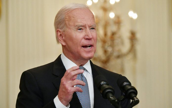 Biden warns states with low immunization rates may see cases rise again