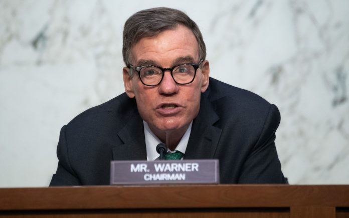 Mark Warner calls for mandatory reporting of hacks after Colonial Pipeline attack