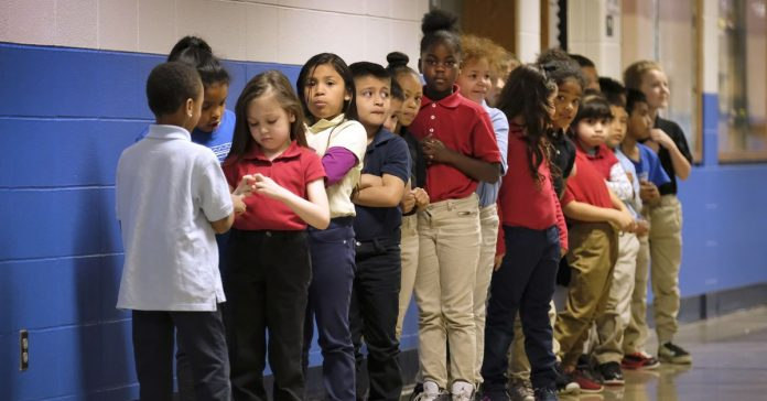 Michigan may pause law that flunks third graders over reading