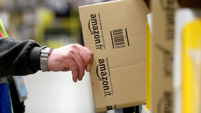 File photo dated 13/11/17 of an Amazon associate collecting packaging at the Dunfermline fulfillment centre, Fife.