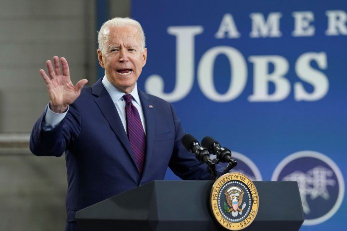 Biden takes his bipartisan infrastructure deal road show to Wisconsin