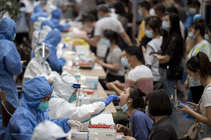 China's Guangzhou reports zero new cases for first time in new cluster