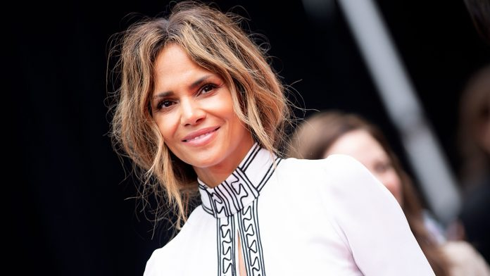 Halle Berry wows in two-piece as she declares 'if it requires a bikini, my answer is always yes please!'