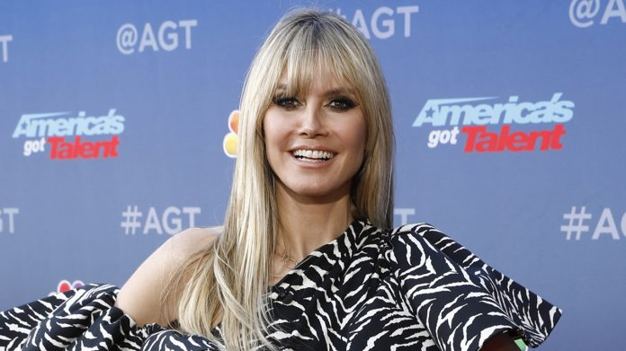 Heidi Klum shows off toned abs in revealing crop top while supporting Germany's soccer team