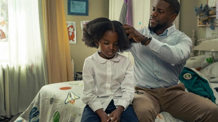 """(From left) Melody Hurd as Maddy and Kevin Hart as Matt star in """"Fatherhood."""""""