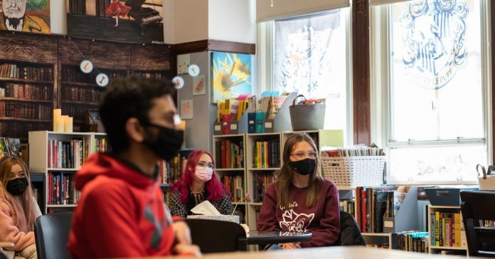 Michigan urges schools to require masks to protect against COVID