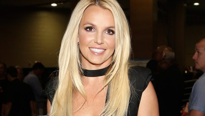 Britney Spears tells 'haters' to kiss her 'a--' after social media debates missing neck tattoo: 'I edited' it