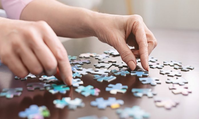 Puzzles, card games later in life may delay Alzheimer's onset by five years, study finds