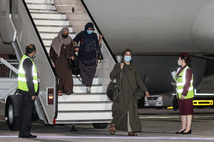 Afghan evacuee flights will be halted for a week after measles cases
