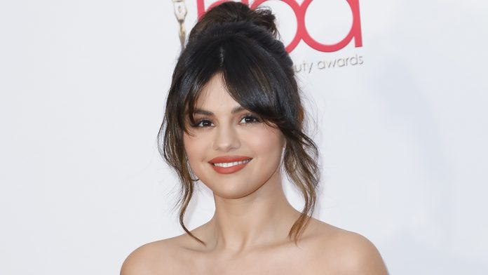 Selena Gomez shows off new helix ear piercing: 'Got something right here'